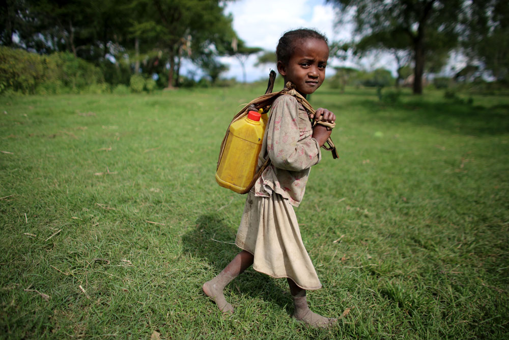 wihs-image-2014_a-young-girl-collects-water-in-ethiopia_credit-josh-estey (smaller image)